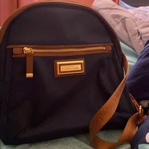 Calvin Klein navy blue nylon backpack brown straps